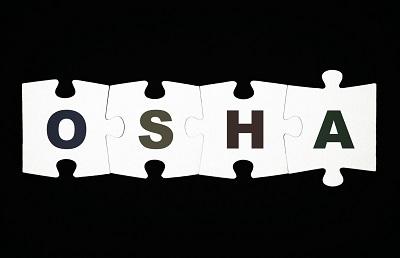 Puzzle pieces spelling OSHA